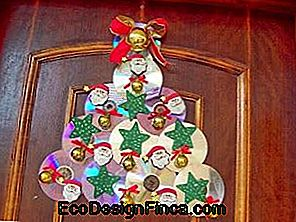 Christmas ornament with CD in tree format hanging on front door
