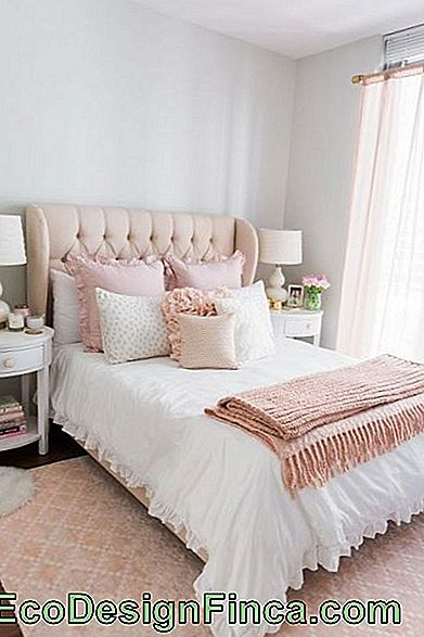 light pink carpet in romantic double bedroom