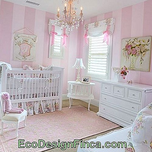 light pink textured rug in baby's room