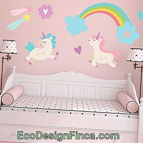 Just look at that cute little room with the unicorn theme