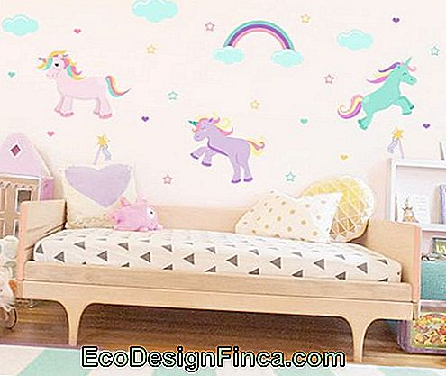 Children's room with pretty cuddly unicorn wallpaper