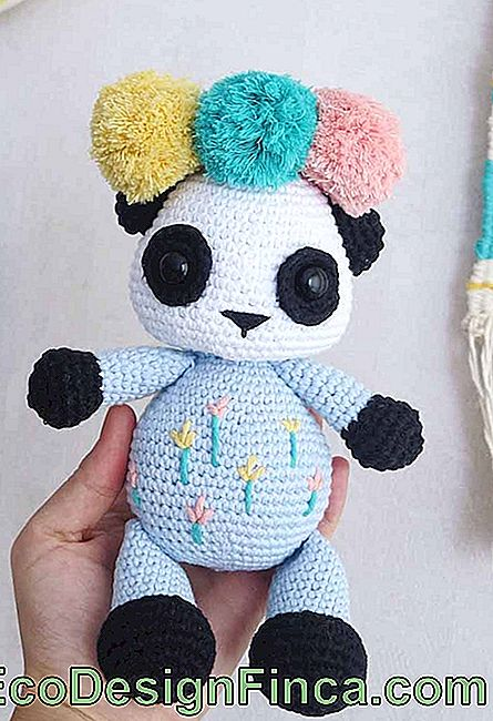 How to make a panda even more charming? Put pompoms in it