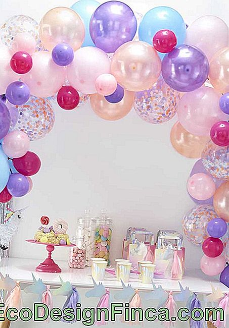 Sweet table with delicate balloons in party color