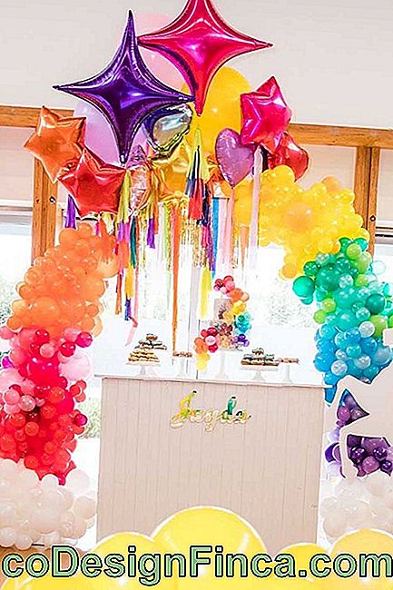 Choice of bladder bow in rainbow colors built with small balloons and floating metallic balloons