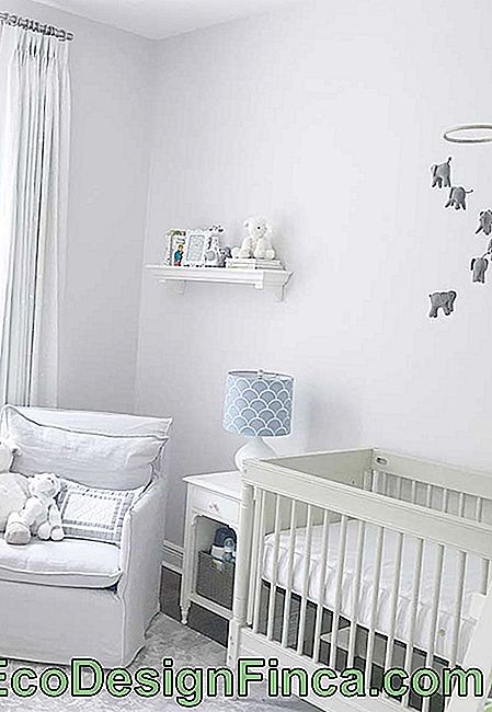 White, gray and blue in small baby room