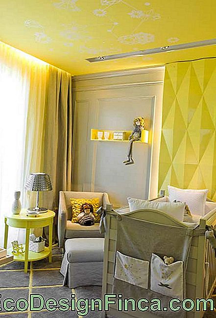Small unisex baby bedroom with yellow and gray colors