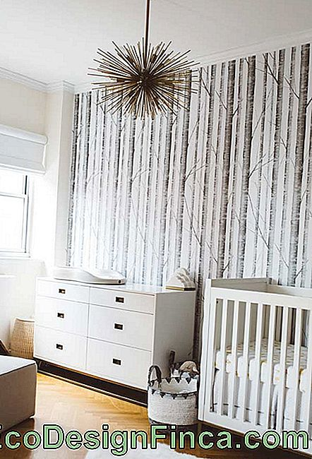 White and wood for small baby room