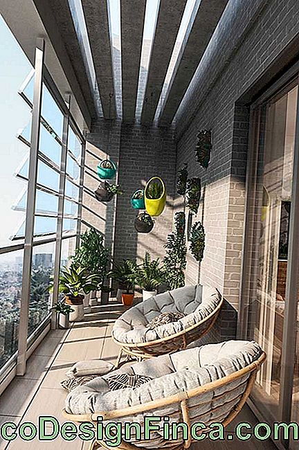Here, the balcony is doubly enclosed by glass; first between the balcony and the internal area and then the front, at the end of the apartment