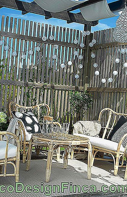 Wicker furniture on wooden porch