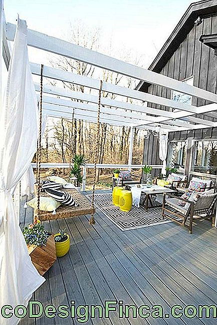Wooden balcony with white painted wooden pergola