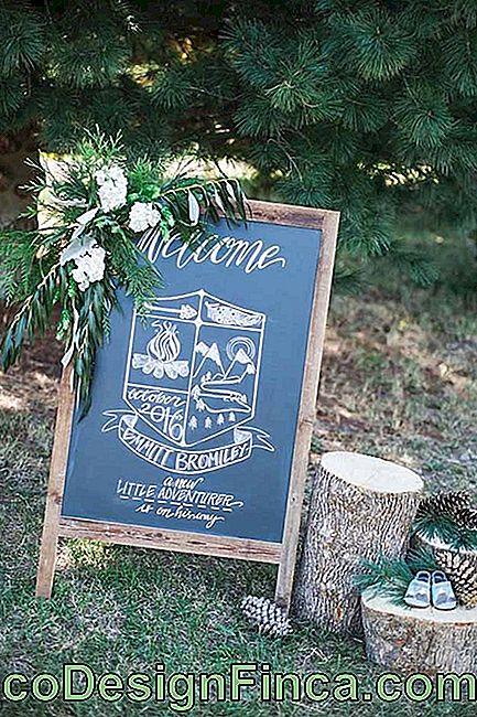 The Chalkboard welcomes the wedding party accompanied by a floral arrangement.