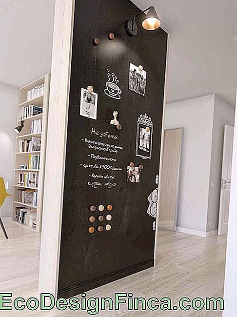 The hallway is a great place to house a Chalkboard, this one still uses photos to complete the decor