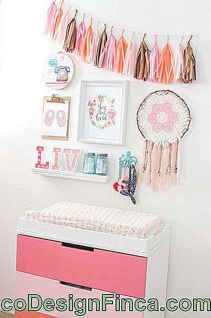 In this girl baby room, the dresser follows a delicate shade of rose shades