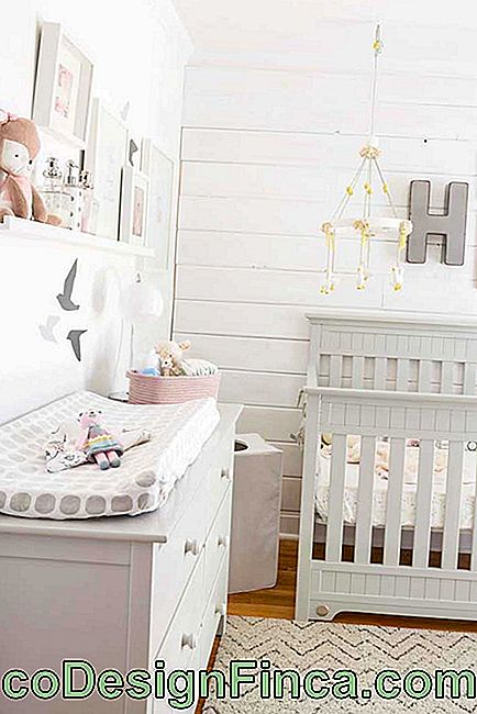 Chest of drawers with changing table and cot
