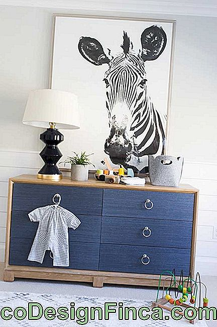 Details in gold to differentiate the dresser in the baby's room