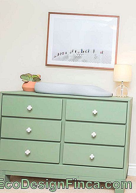The delicate green of the dresser brings calm to the baby's room