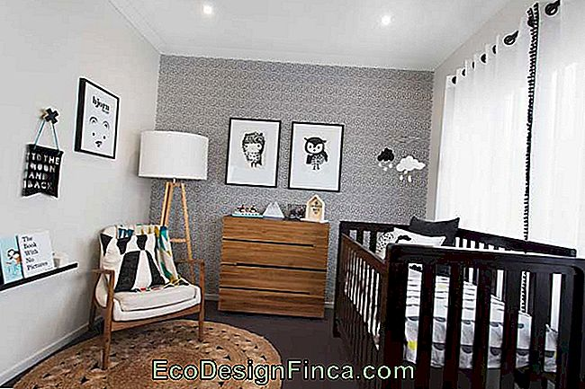 Wooden chest of drawers for the baby's room in a lighter shade than the crib