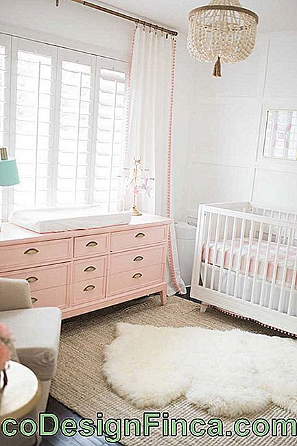 Wooden baby room dresser: modern and distinctive model