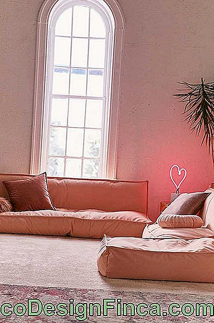 Futon-style twill sofa in the color of the year 2019, the living coral