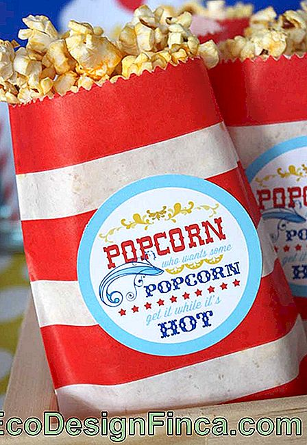 Serve popcorn in personalized sachets like those found in circuses.