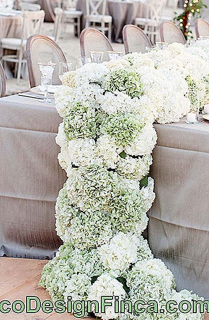 Natural hydrangea bouquets were used to mount this huge table arrangement