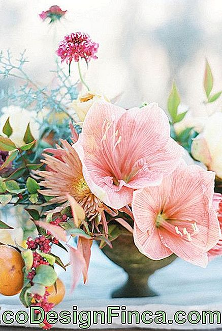 Lilies and chrysanthemums form this rustic and laid back table setting