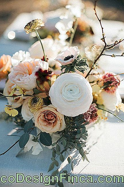 Outdoor wedding decorated with peonies flowers