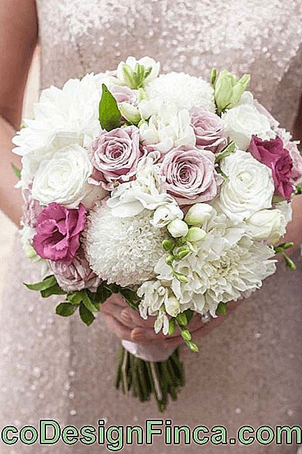 Delicate bridal bouquet with chrysanthemum flowers, roses and lisianthus